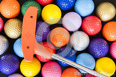 Mini Golf Balls and Club Stock Photo