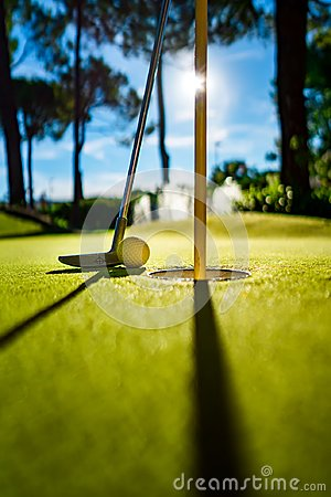 Free Mini Golf Yellow Ball With A Bat Near The Hole At Sunset Stock Photography - 110077712