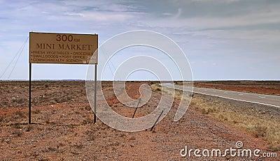 Mini Market 300km ahead road sign