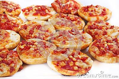 Mini pizza bagels on white
