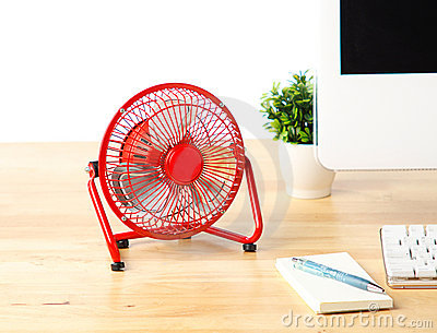 Mini red fan isolated on the desk