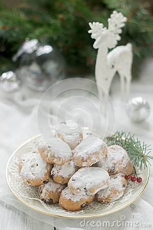 Mini Stollen or Stollen candy in the background with a deer figure, Christmas balls and fir branches. Stock Photo