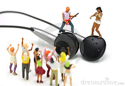 Miniature band on a pair of ear buds. MP3 concept.