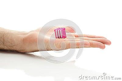 Miniature books in hand