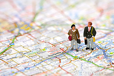 Miniature business travelers on a map.