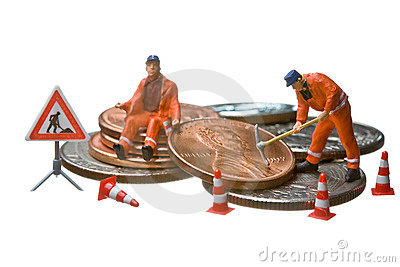 Miniature figures working on a heap of Dollar coin