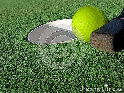Miniature Golf Ball and Putt Near Hole