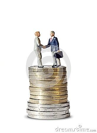 Miniature handshake euro coin tower