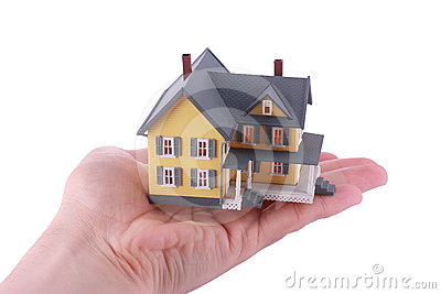 Miniature house over hand