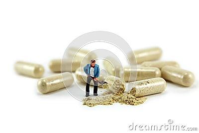 Miniature man digging medicine