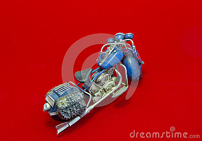 Miniature Motorcycle on Red Background