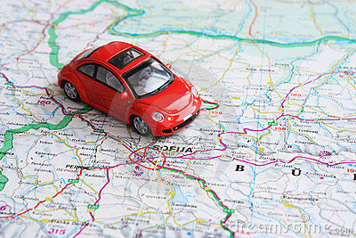Miniature red car over Bulgaria map