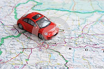 Miniature red car over Bulgaria map