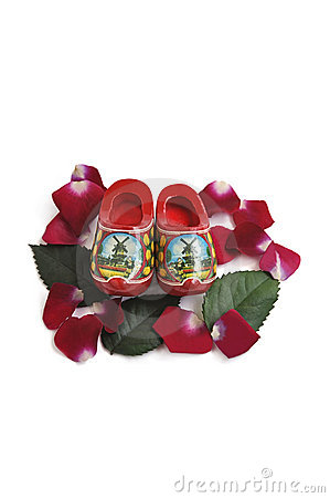 Miniature wooden shoes, rose petals and leaves.