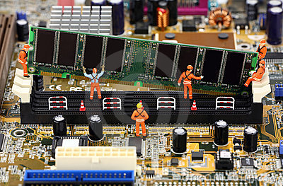 Miniature Workers Installing RAM Memory Royalty Free Stock Images - Image: 3680239