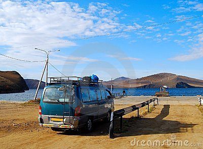 Minibus wait for a car ferry