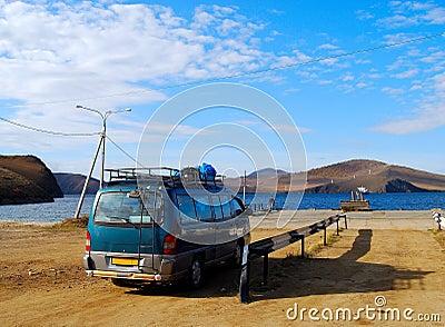 Minibus wait for a car ferry