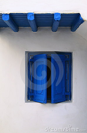 Minimalist blue window on whitewash