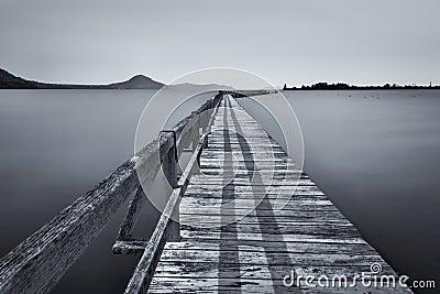 Minimalist of jetty at lake taupo stock photo image for Minimalist house lake taupo
