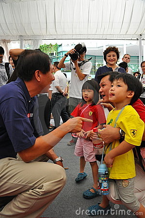 MINISTER TEO INTERACTING WITH KIDS Editorial Photography