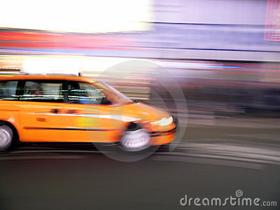 Minivan taxi speeds through Times Square, New York City