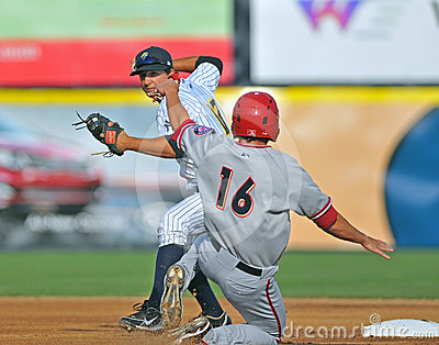 Minor league baseball - double play at second Editorial Stock Image