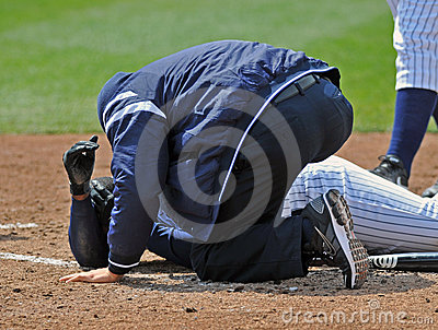 Minor League baseball injury at the plate Editorial Photo