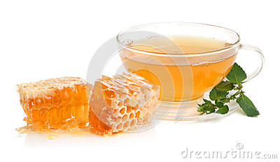 Cup of green tea with mint leaves and honey on white background.