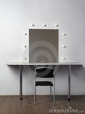 Mirror with lamps for makeup, black chair