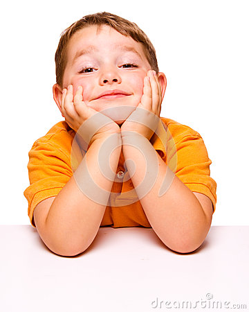 Free Mischievous And Bored Child Sitting At Desk Royalty Free Stock Photo - 25272585