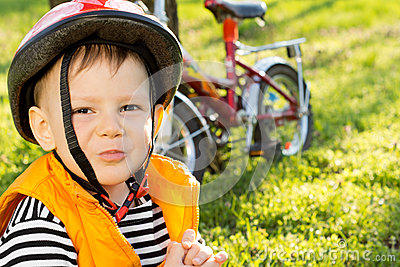 Mischievous little boy in a safety helmet