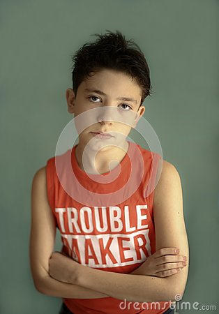 Free Mischievous Teenager Boy In Trouble Maker T-shirt Close Up Sad Portrait Royalty Free Stock Image - 115999096