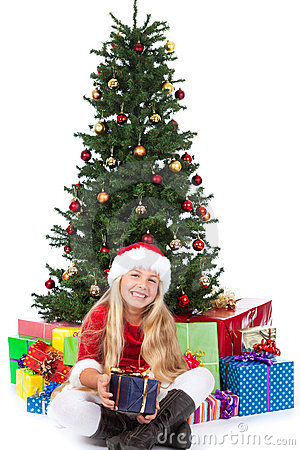 Miss santa before christmas tree and gifts