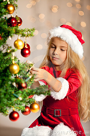 Free Miss Santa Decorating The Christmas Tree Stock Photos - 20445113