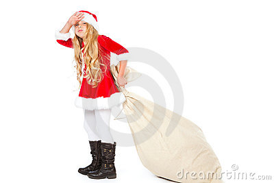 Miss santa exhausted of pulling heavy gift sack