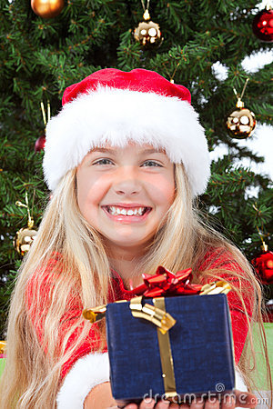 Miss santa holding a gift and smiling