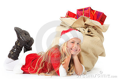 Miss santa lying beside christmas sack smiling