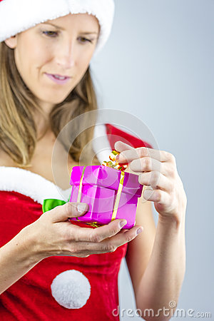 Miss santa oppening a present