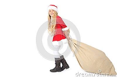 Miss santa pulling the heavy santa claus sack
