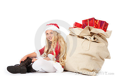 Miss santa sitting beside christmas sack smiling
