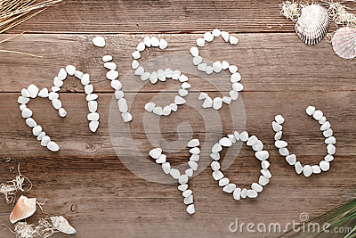 Miss You Love Words Written in Pebbles on Old Wood