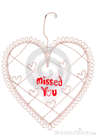 Missed you message on a heart note board