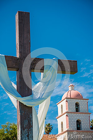 Mission Santa Barbara with cross and sky blue background Stock Photo