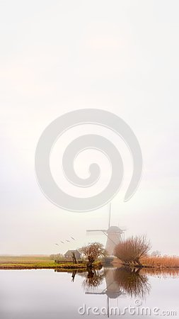 Free Misty And Calm Windmill Sunrise Stock Photography - 103846872
