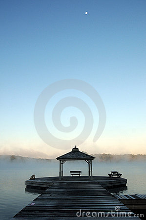Free Misty Morning At Lake Rosseau Pier With Moon Stock Photo - 21250090