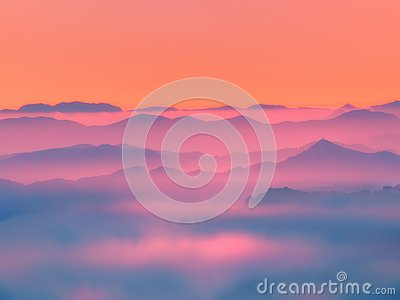 Misty mountains silhouettes Stock Photo