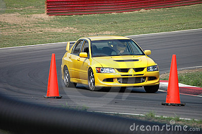 Mitsubishi Evolution Sedan driving on Race Course