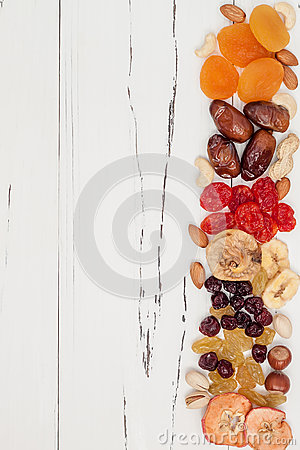 Free Mix Of Dried Fruits And Nuts On A White Vintage Wood Background With Copy Space. Top View. Symbols Of Judaic Holiday Tu Bishvat. Stock Photos - 70620523