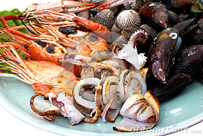 Isolated white background.Mix sea food on disc