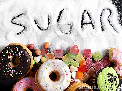 Mix of sweet cakes, donuts and candy with sugar spread and written text in unhealthy nutrition Stock Photo